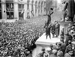 Charlie Chaplin stands on Douglas Fairbanks' s...