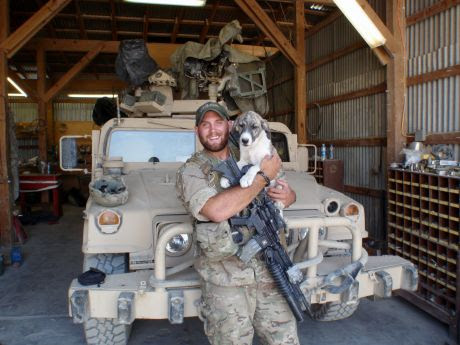 Sgt. Tim Johannsen and the puppy Leo.