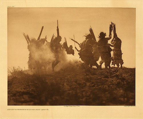Edward S. Curtis.  Dancing to restore an eclipsed moon - Qagyuhl (The North American Indian; v.10)