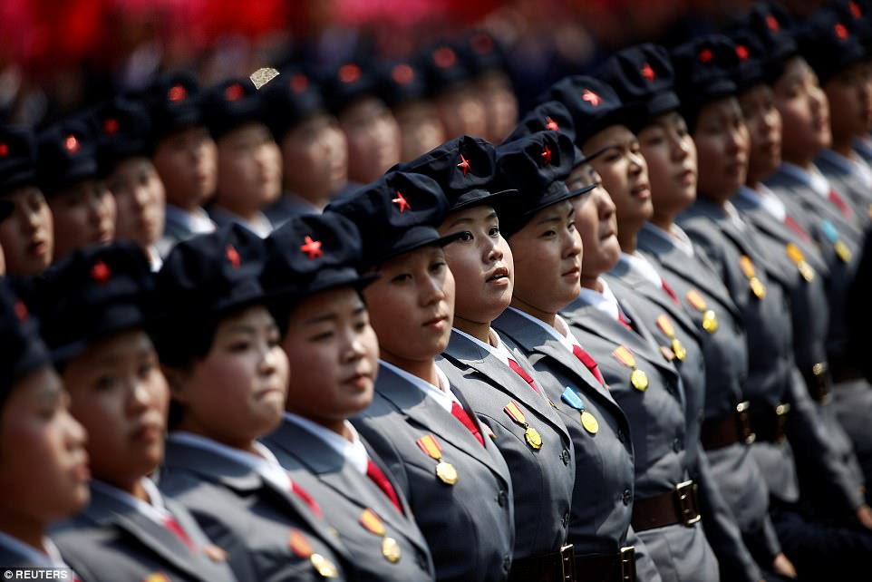Lines of uniformed female soldiers joined in the flamboyant display of patriotism in the heart of the North Korean capital