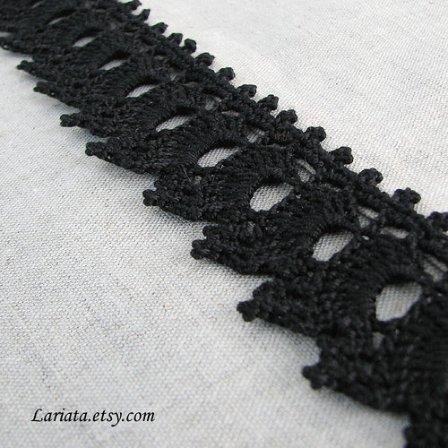 handmade crocheted lace on a natural linen table runner
