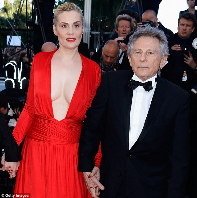 Blimey! Leading lady Emmanuelle Seigner and Roman Polanski attend the La Venus A La Fourrure premiere during The 66th Annual Cannes Film Festival