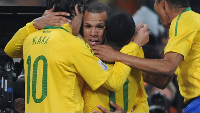Luis Fabiano celebrates with Kaka and Robinho