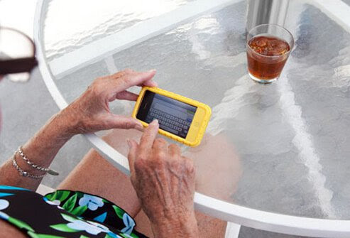 Photo of older woman texting.