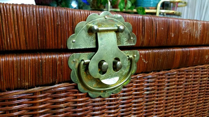 ornate brass hardware on wicker trunk vintage boho style