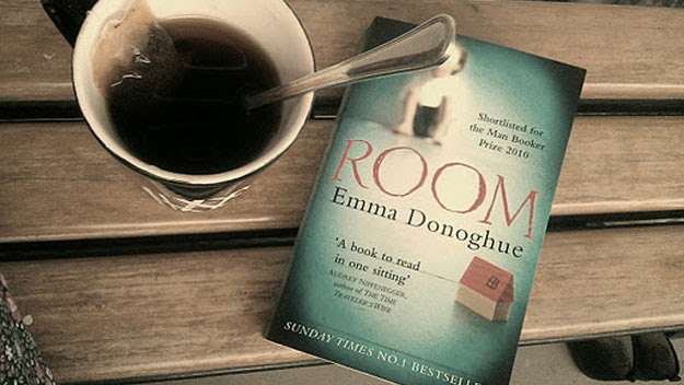 Novel and cup of tea on table