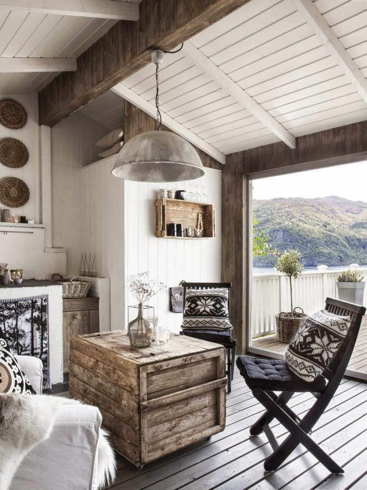 Living room in a white rustic Scandinavian cottage