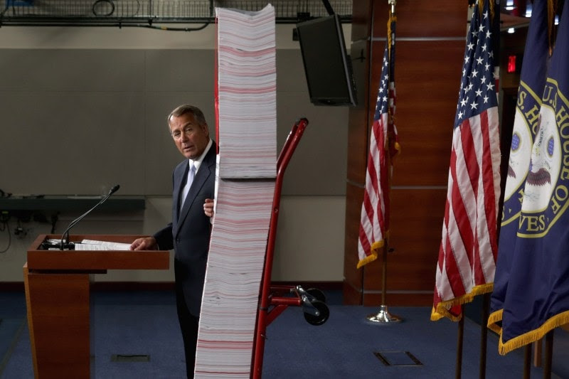 Speaker of the House John Boehner (R-Ohio) stands next to a printed version of  Obamacare during a news conference on May 16. (Photo by Chip Somodevilla/Getty Images)
