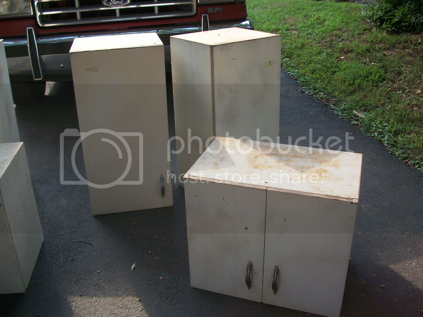 sale and thrift shop pickups  steel cabinets, typewriter, glass caddy