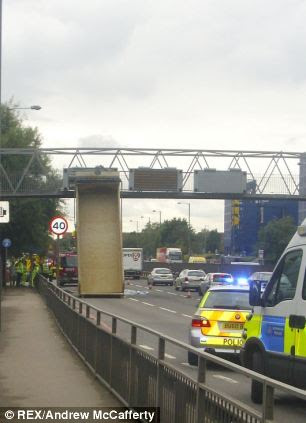 The truck was left wedged against the bridge at around 1pm today
