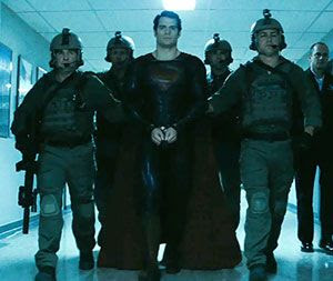 Superman (Henry Cavill) is placed into custody by U.S. soldiers in MAN OF STEEL.