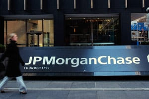 A pedestrian passes the JP Morgan Chase building in midtown  Manhattan on Jan. 16, 2008, by which time its CDO with Magnetar called  Squared had dropped to a fraction of its initial value. (Chris  Hondros/Getty Images)