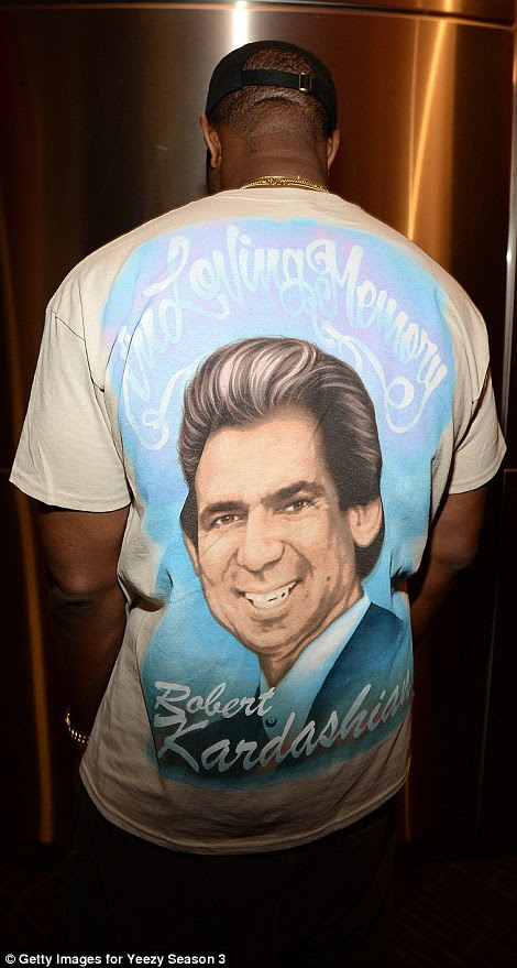 'In loving memory': Kanye wore a T-shirt with a portrait of his late mother, Donda West, on the front, and Kim's late father, Robert Kardashian, on the back