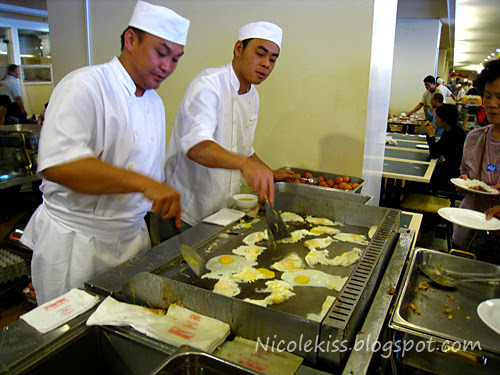 chefs frying eggs