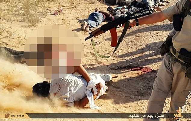 A couple of jihadists approach the dead prisoners and finish off any survivors from point-blank range
