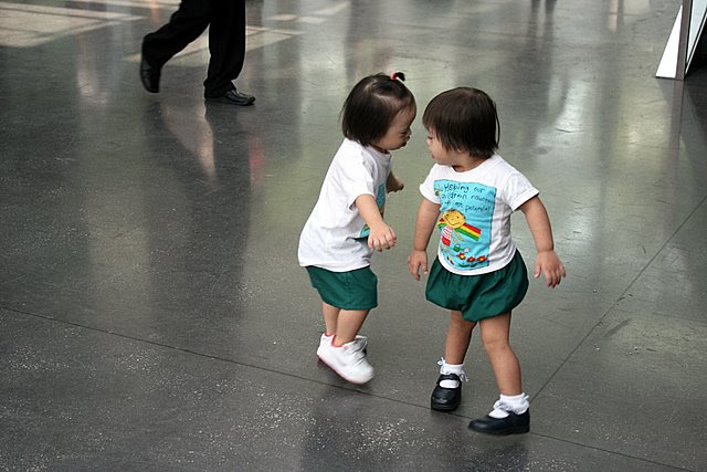 Nadine and classmate Mei-Ling doing a dance