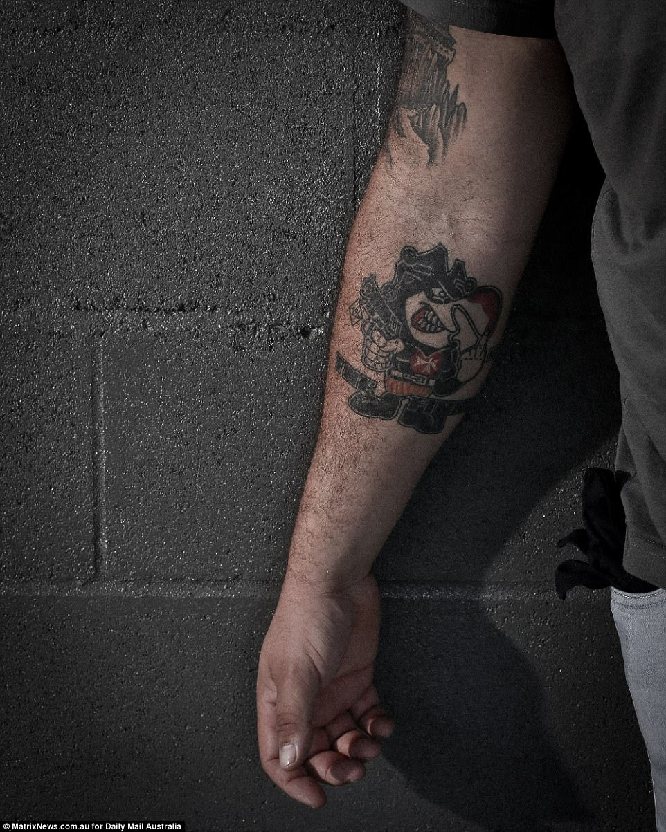 A dedicated member shows off his Finks tattoo which features the club's mascot which ironically holds a gun