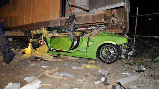 Alleged Drunk Driver Busted After Getting $200,000 Lamborghini Wedged Under Trailer