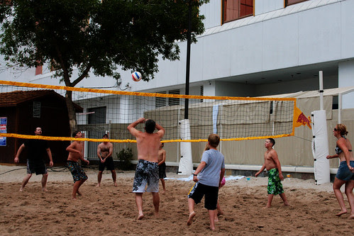 bomber boys and parents playing volleyball at the pool