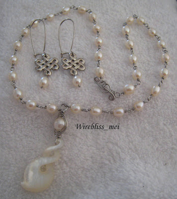 wire wrap pearl necklace with matching earrings and herringbone woven pearl focal