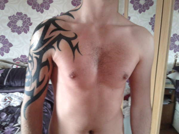 Upper Arm And Chest Tribal Tattoo