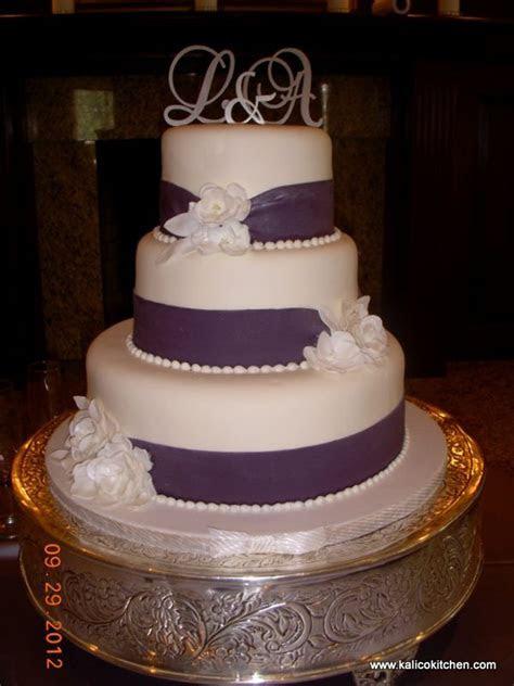 Wedding Cakes  3 tier, fondant, wide purple ribbons   3