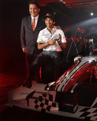 Base Batteries Chief Operating Officer Aditya Arora, Left, And Hispania Racing Team Driver Narayan Karthikeyan Show A