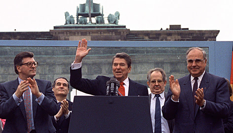 """Reagan acknowledges the crowd after his speech in front of the Brandenburg Gate in West Berlin on June 12, 1987. At the time, though, it received a muted reception. But two decades later, the speech has passed into history as one of the """"great communicator's"""" most stirring moments."""