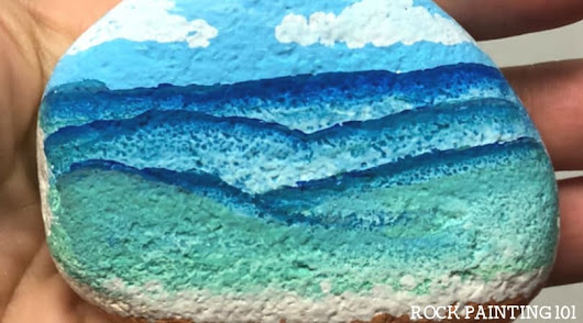 Learn how to paint waves onto a beach painted rock!