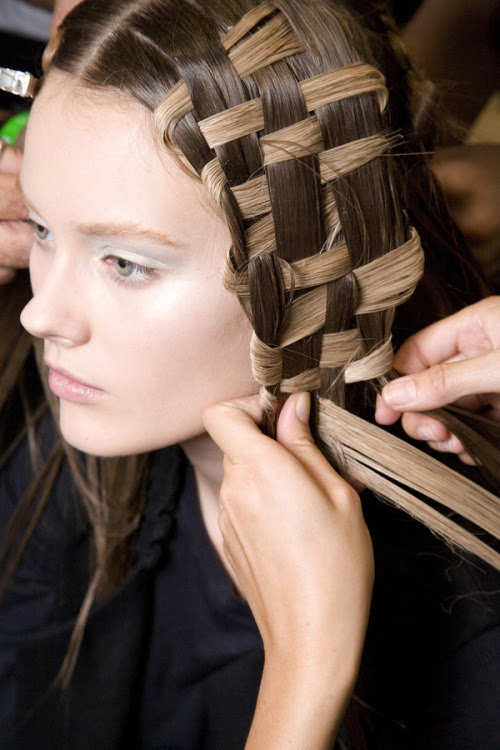 Basketcase A how-to look at getting the Alexander McQueen spring 11 woven hairstyle by Guido. What you'll need: unlimited amounts of hairspray and defrizzer, straightening iron, extensions, and 2 patient friends. Check out some of our favorite tress tamers for the season here! Photo: Imaxtree