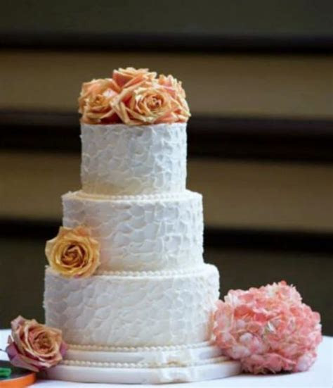 Round 3 tier white smaller size wedding cake with orange