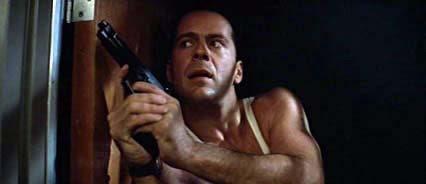 John McClane (Willis) closes in on the Bad Guys