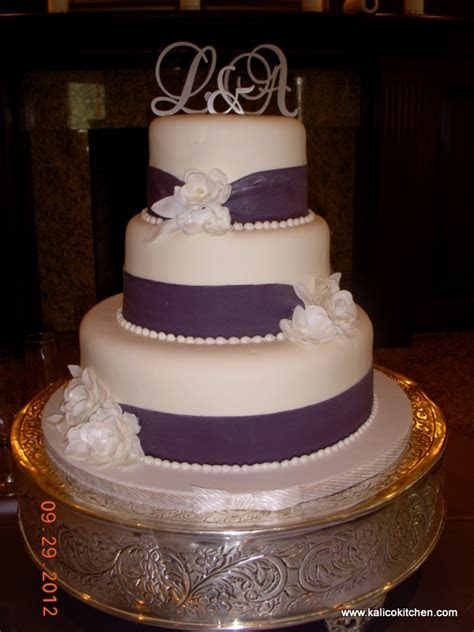 Wedding Cakes  3 tier, fondant, wide purple ribbons   3