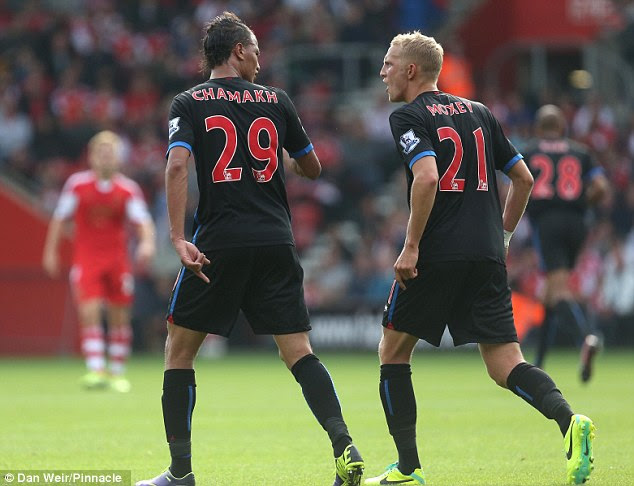 Angry duo: Chamakh made no secret of the fact he was unhappy to be booked