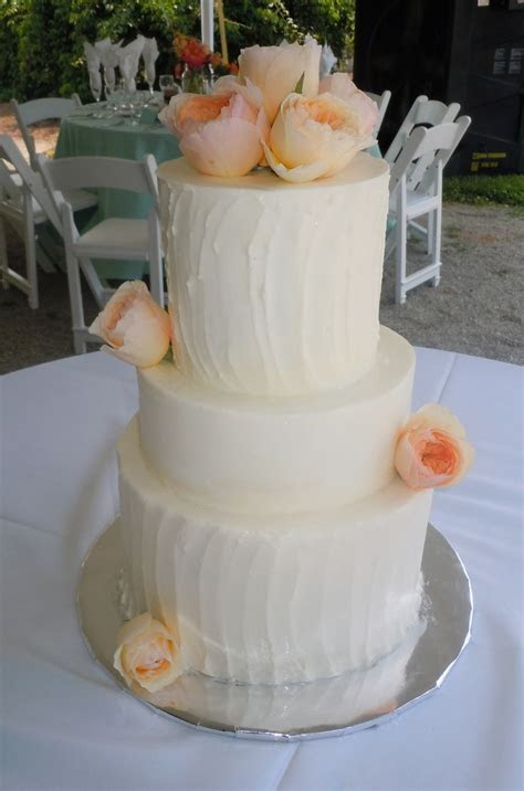 Contrasting rough and smooth iced buttercream wedding cake