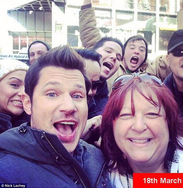 Starting a trend? In one shot, a group of men in the background also posed with their mouths opened wide
