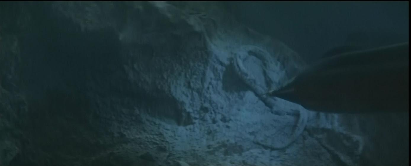 Manda, frozen, as Atragon passes by.
