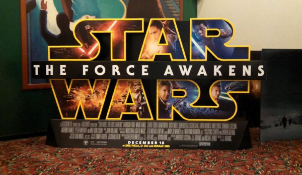 A cardboard marquee for STAR WARS: THE FORCE AWAKENS is displayed at the AMC 20 theater in my hometown...on November 14, 2015.