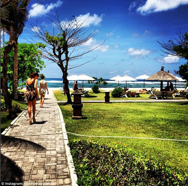 Blue skies: On a French Riviera jaunt, Naomie bosted: 'In two days, the temperature will drop to 35 degrees (... take advantage, enjoy !!! #sun #tan #Djerba #SoGood' Above, Naomie on holiday in Bali