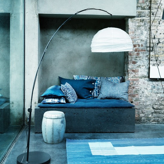 Modern blue and white living room with exposed brick and concrete ...