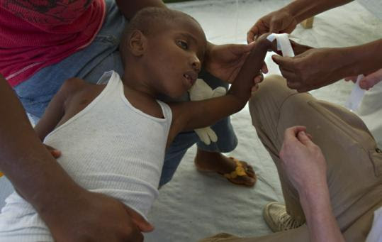 A boy suffering from cholera was treated in Port-au-Prince, Haiti, yesterday. Thousands have been sickened by the disease.