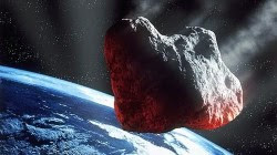 Artists impression of an asteroid flying by Earth. Credit: NASA
