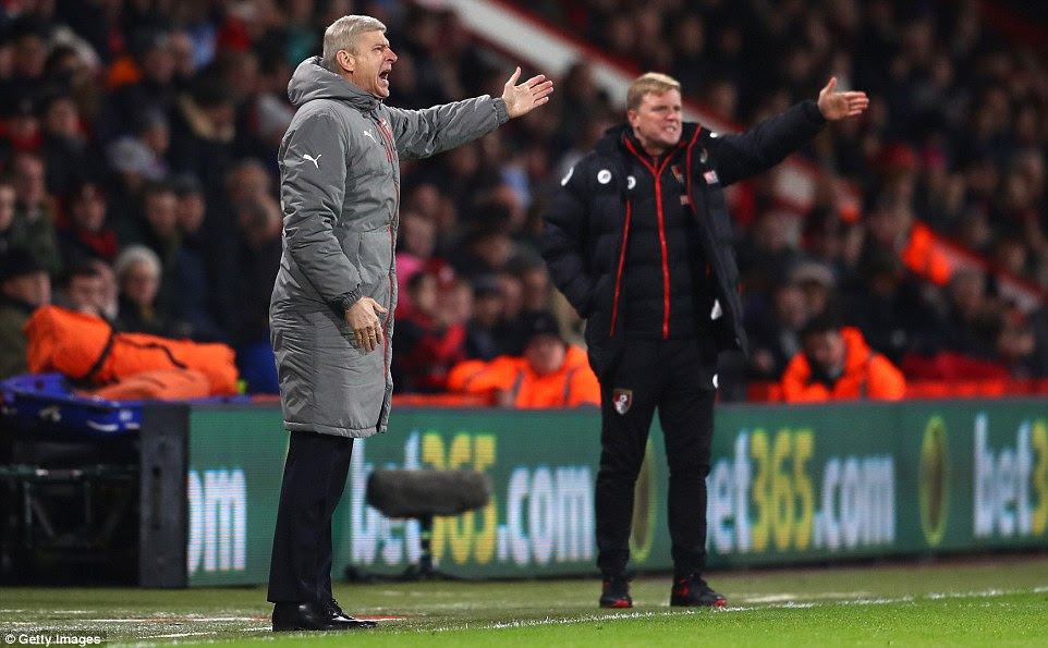 Arsenal manager Wenger and Bournemouth boss Eddie Howe pictured on the touchline on Tuesday night
