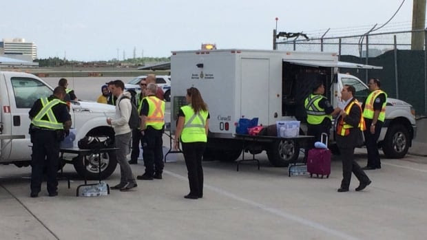 Passengers were rescreened on the tarmac in Toronto after 17 flyers got on board an Air Canada flight in Paris without the required preboarding security screening.