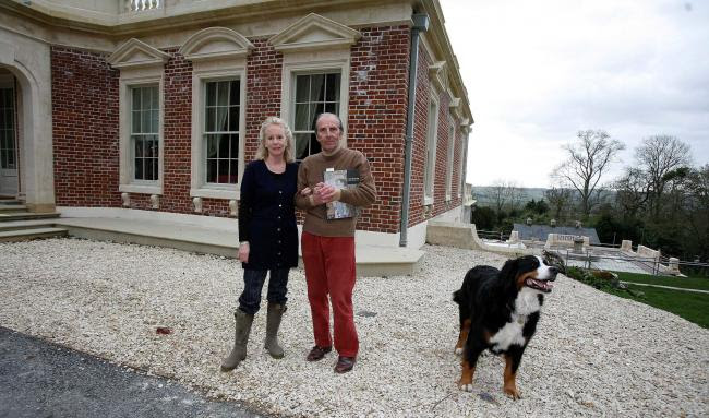 File photo of Esmond Bulmer with his wife Susie and dog Echo outside their home