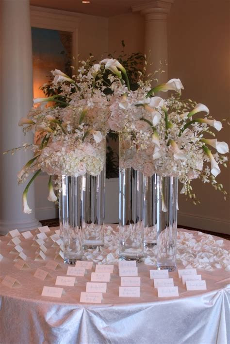 Gorgeous escort card table. Decor by Greenery Productions