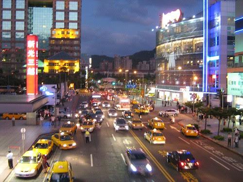 Cars near shopping malls at night