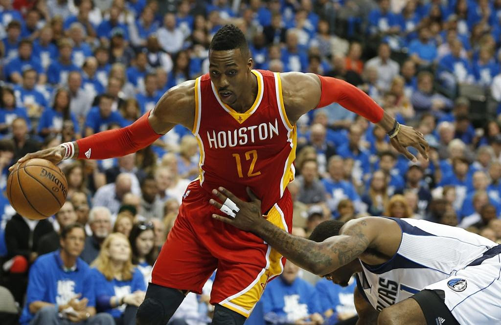 With or without the ball, Dwight Howard was a problem for the Mavericks all night on Friday, finishing with 13 points and 26 rebounds in the Rockets' Game 3 victory. (James Nielsen  /  Houston Chronicle)