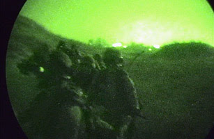 Israeli naval commandos are seen through night-vision gear as they launch a raid against Hezbollah fighters August 5, 2006 in south Lebanon city of Tyre.
