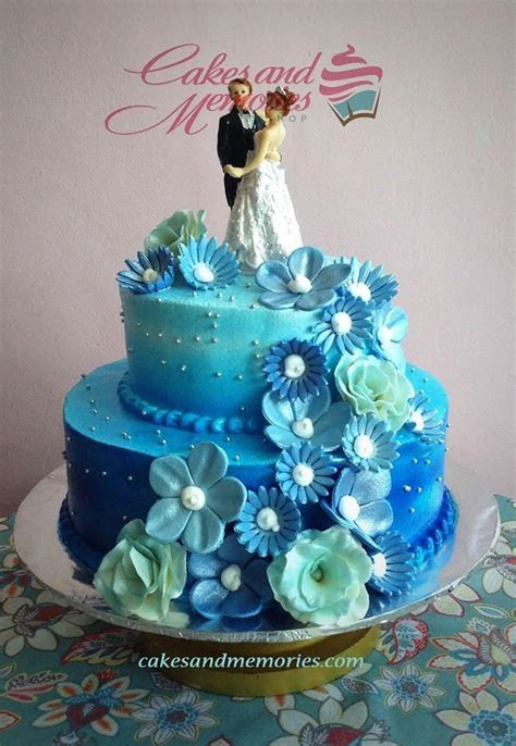 Blue Ombre with Cascading Flowers Wedding Cake ? Cakes and